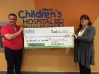Cheque donation to Albnerta Childrens Hospital
